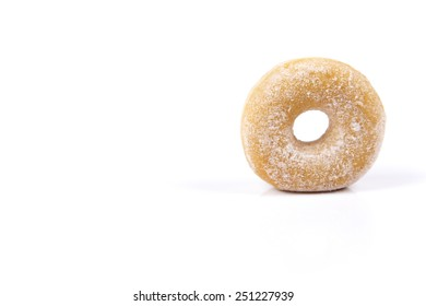 Fresh donut with icing sugar isolated on white background