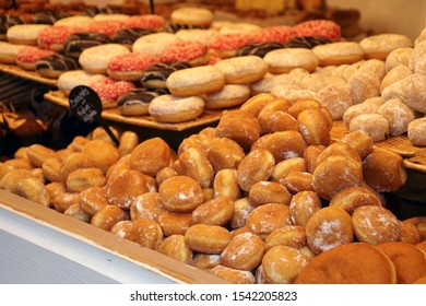 Fresh donuts prepared in the Christmas market of Paris, France