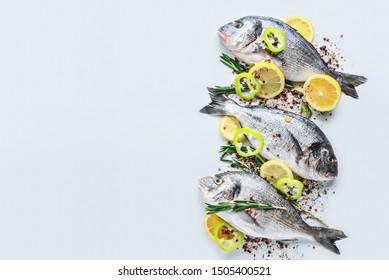 Fresh dorado fish and spices on white background