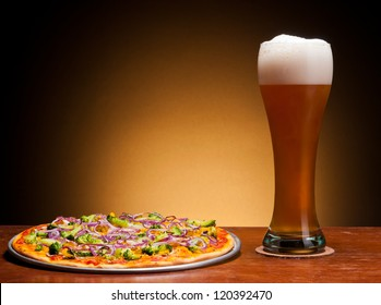 fresh draught beer and pizza with vegetables