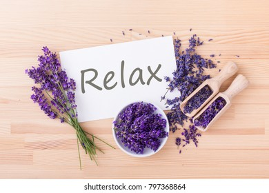 fresh and dried lavender and card with text: Relax