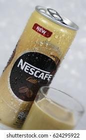 fresh drink of nescafe latte with wet background