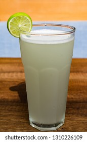 Fresh drink photo of home made limonade on wooden background.