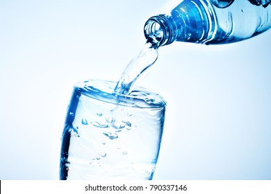 Fresh drinking water is poured in a glass.