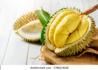 Fresh durian (Kan yao) or Durio zibthinus Murray on sack and old wood background, king of fruit from Thailand on summer season