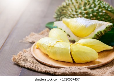 Fresh durian (monthong) on sack and old wood background, king of fruit from Thailand on summer season