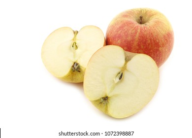 fresh Dutch cooking apple and a cut one on a white background