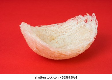 Fresh edible bird's nest on red paper