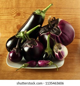 fresh eggplant or aubergine bringal varieties in wooden background