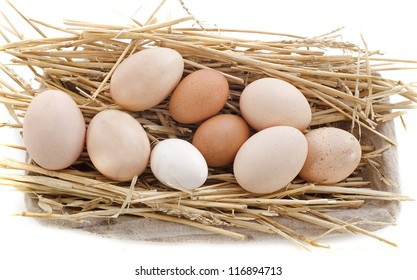 fresh eggs in a basket with straw