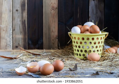 Fresh eggs are placed on a wooden table and fresh eggs are placed in a basket in an organic farm.