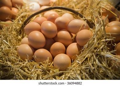 Fresh eggs in straw basket in the market.