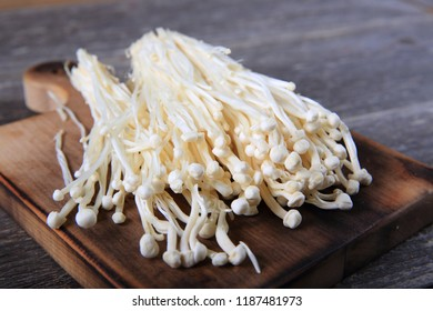 Fresh Enoki Mushroom on Wooden Board