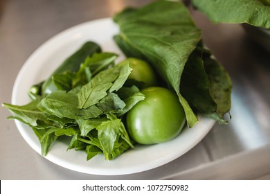 Fresh epazote and green tomato, traditional ingredient in mexican cuisine