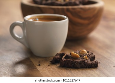 fresh espresso with homemade cookie with hazelnuts