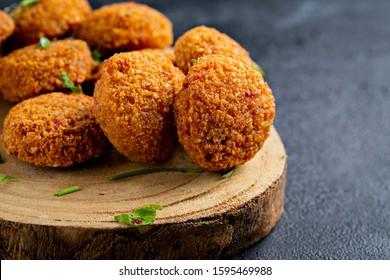 Fresh falafel balls on a black background. Image