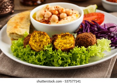 fresh falafel balls served with salad and hummus.