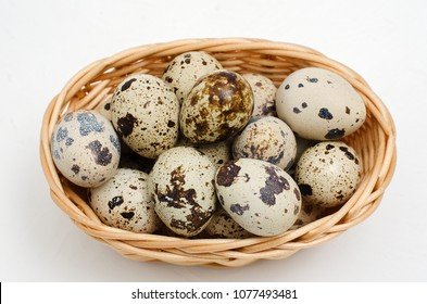 Fresh, farm, raw quail eggs on white background. Protein diet. Healthy diet.