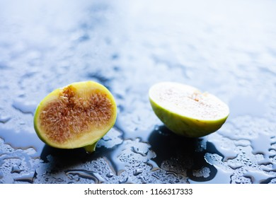 Fresh fig on a black background, cut in half, selective focus