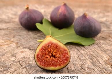 Fresh fig on wood background.
