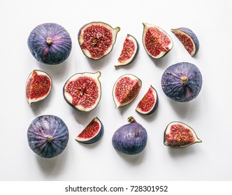 Fresh figs. Food Photo. Creative scheme of the whole and sliced figs on a white background, inscribed in a rectangle. View from above. Copy space