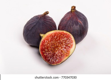 Fresh figs isolated on white background. Figs cut in half, in section