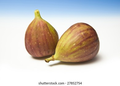 Fresh figs on a blue studio background.