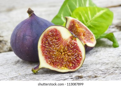 Fresh figs on old wooden background