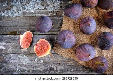 Fresh figs on vintage wooden background