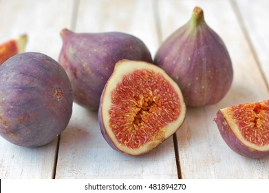 Fresh figs on white wooden background,front horizontal view