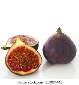 Fresh figs whole and cut isolated on white background