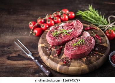 Fresh fillet Steak on table