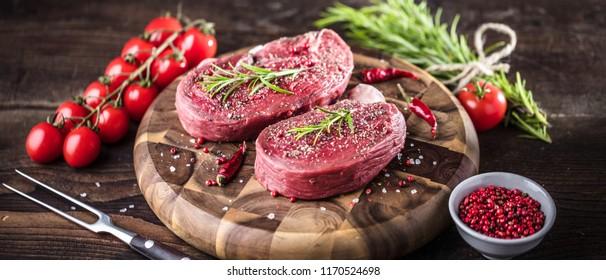Fresh fillet Steak on wooden background