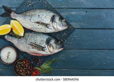 Fresh fish with aromatic herb.  top view, healthy food, diet or cooking concept - Shutterstock ID 580964596