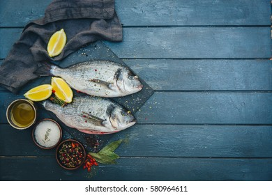 Fresh fish with aromatic herb.  top view, healthy food, diet or cooking concept - Shutterstock ID 580964611