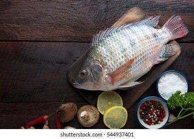 fresh fish with aromatic herbs and spices food concept. top view