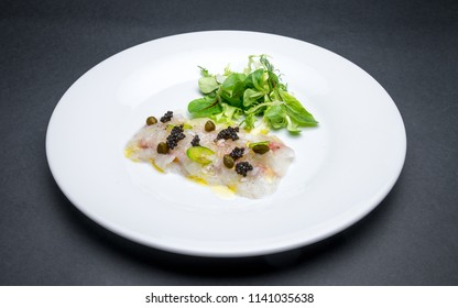 Fresh fish carpaccio with black sturgeon caviar