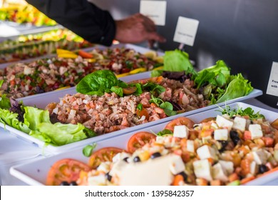 Fresh fish food and vegetables for catering and restaurant exposition concept business - coloured background with healthy meal exposed with notes