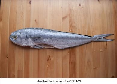 fresh fish mahi-mahi on wooden board