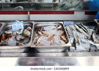 Fresh fish on the counter on the Greek island in the port covered with ice, different types of fish, fish delicacies