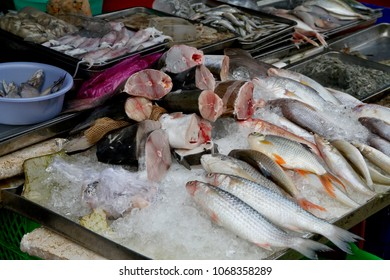 Fresh fish on display in a seafood produce market in Vietnam.