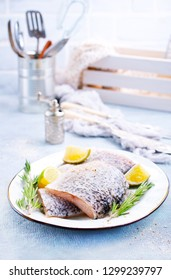 Fresh fish, raw cod fillets with rosemary and salt