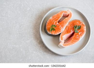 fresh fish. fresh salmon steaks in a light plate.
