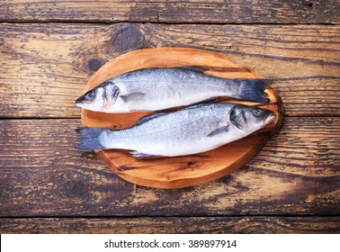 fresh fish sea bass on wooden table
