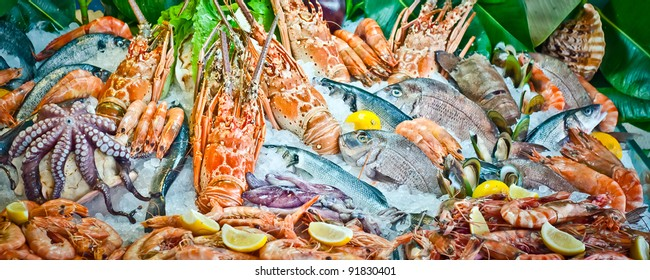 Fresh fish and seafood arrangement displayed on the market.