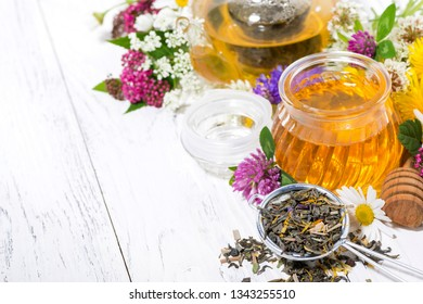 fresh flower honey, tea and ingredients on white background, top view horizontal