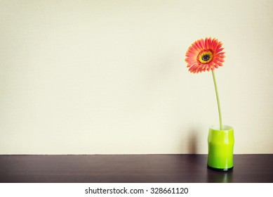 Fresh flower on the wooden table. Instagram filter.