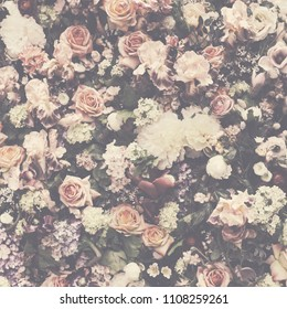 Fresh flower pattern background for vintage wedding decoration and invitation design layout. Floral bouquet wall arrangement in retro style pastel colors.