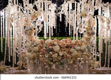 Fresh flowers in a wedding decoration. Night Banquet