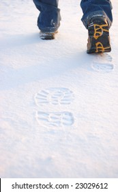 Fresh footprints from man boots on snow